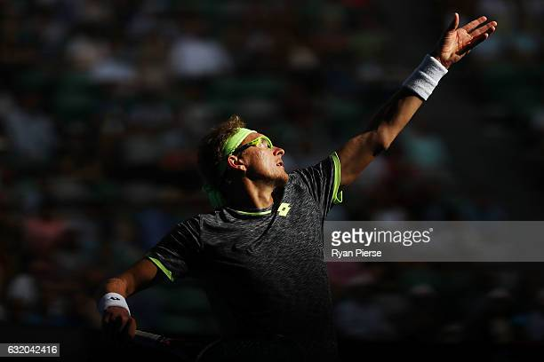 Denis Istomin of Uzbekistan serves in his second round match against Novak Djokovic of Serbia on day four of the 2017 Australian Open at Melbourne...