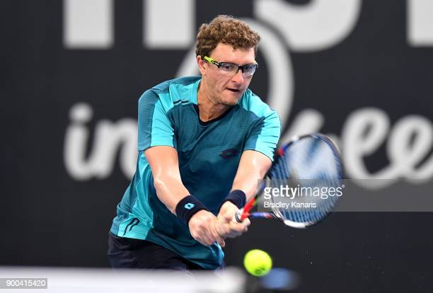 Denis Istomin plays a backhand in his match against Damir Dzumhur during day three of the 2018 Brisbane International at Pat Rafter Arena on January...