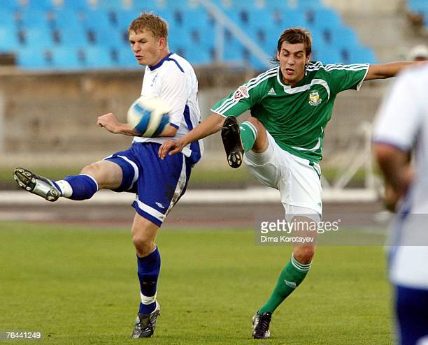 Denis Kolodin of FC Dynamo Moscow competes for the ball with Anton Arkhipov of FC Tom Tomsk during the Russian Football League Championship match...