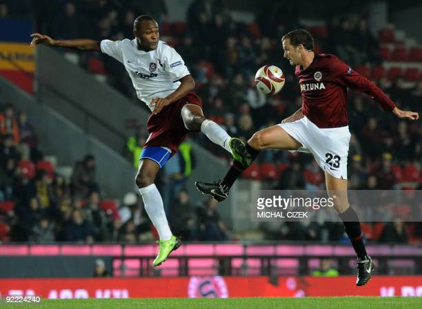 Denis Kovba of Sparta Prague fights for the ball with Nei of CFR 1907 Cluj during the UEFA Europa League Group K football match between Sparta Prague...