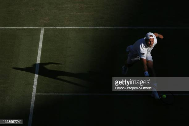 Denis Kudla in action against Novak Djokovic during their Gentlemen's Singles 2nd Round match on Day 3 of The Championships - Wimbledon 2019 at the...