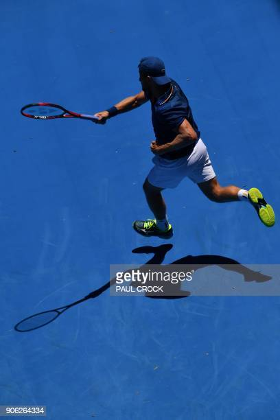 Denis Kudla of the US hits a return against Austria's Dominic Thiem during their men's singles second round match on day four of the Australian Open...