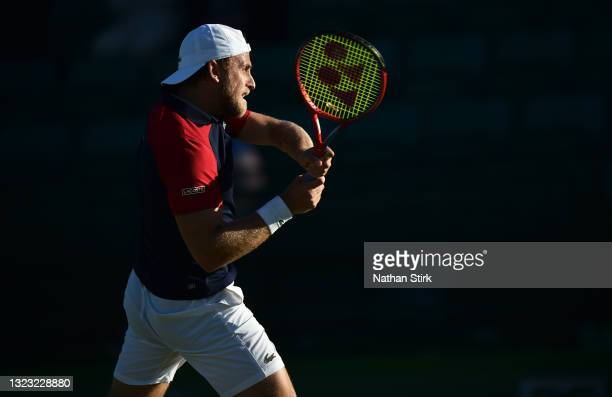 Denis Kudla of United States plays a backhand against Kamil Majchrzak of Poland during the men's semi-finals singles match on day eight of the Viking...