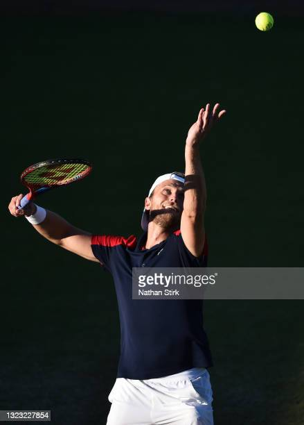 Denis Kudla of United States serves to Kamil Majchrzak of Poland during the men's semi-finals singles match on day eight of the Viking Open at...