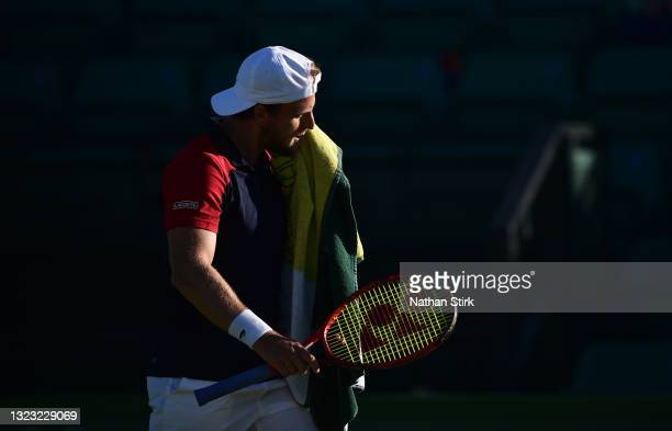 Denis Kudla of United States wipes his face as he plays against Kamil Majchrzak of Poland during the men's semi-finals singles match on day eight of...