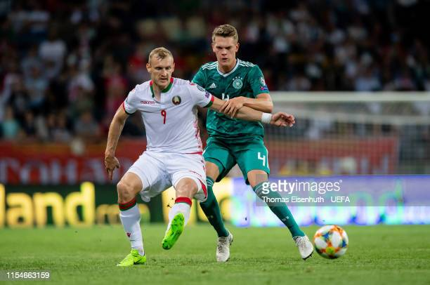 Denis Laptev of Belarus is challenged by Matthias Ginter of Germany during the UEFA Euro 2020 qualifier match between Belarus and Germany at...