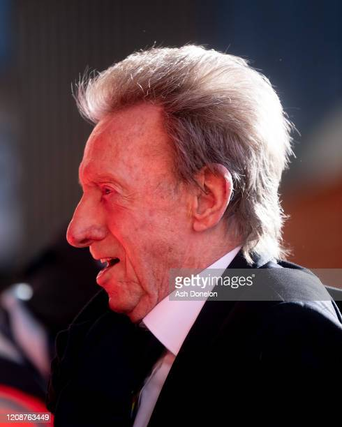 Denis Law of Manchester United arrives ahead of the Premier League match between Manchester United and Watford FC at Old Trafford on February 23 2020...