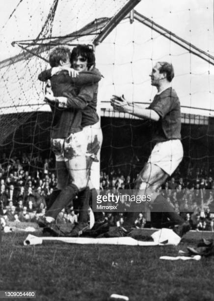 Denis Law of Manchester United is congratulated on his goal by jubilant teammates George Best and Bobby Charlton during an FA Cup Fifth Round match...