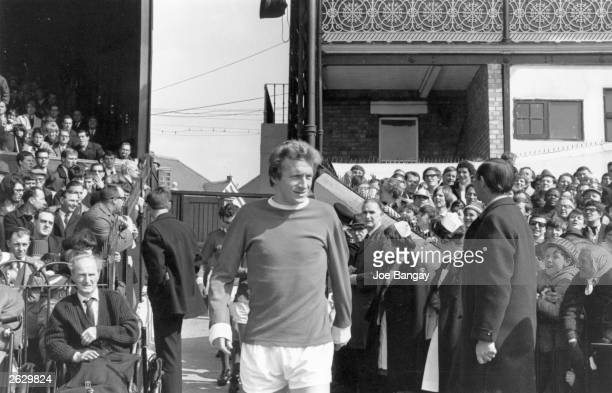 Denis Law the Scottish footballer coming onto the pitch for a Fulham versus Manchester United match