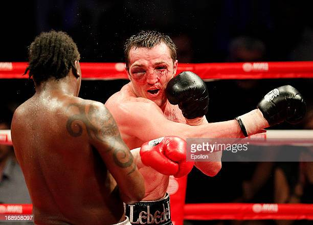 Denis Lebedev of Russia fights with Guillermo Jones of Panama during their WBA cruiserweight title bout at the Crocus City Hall on May 17 2013 in...
