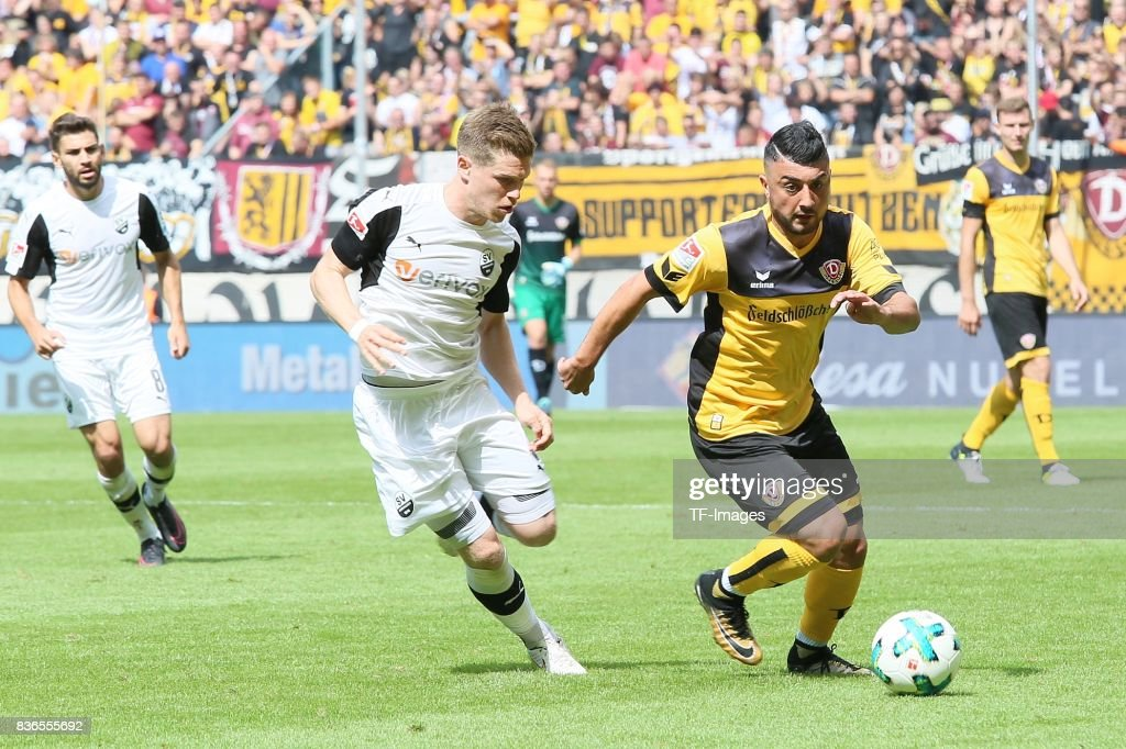 Denis Linsmayer of Sandhausen and Aias Aosman of Dreden battle for the ball during the Second Bundesliga match between Dynamo Dresden and SV Sandhausen at DDV-Stadion on August 19, 2017 in Dresden, Germany.