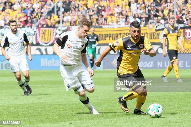Denis Linsmayer of Sandhausen and Aias Aosman of Dreden battle for the ball during the Second Bundesliga match between Dynamo Dresden and SV...