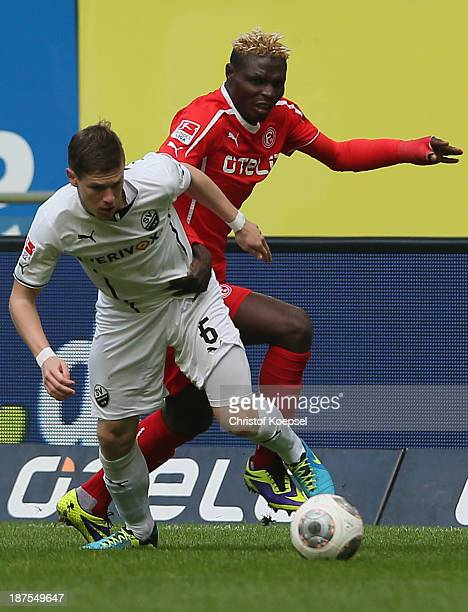 Denis Linsmayer of Sandhausen challenges Aristide bance of Duesseldorf during the Second Bundesliga match between Fortuna Duesseldorf and SV...