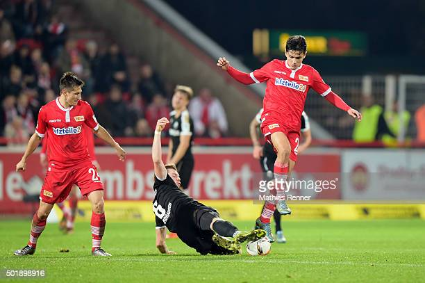 Denis Linsmayer of SV Sandhausen tackles Eroll Zejnullahu of 1 FC Union Berlin during the game between Union Berlin and SV Sandhausen on december 18...