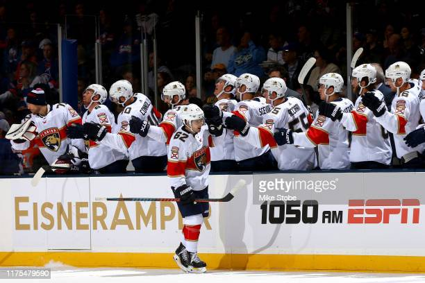 Denis Malgin of the Florida Panthers is congratulated by his teammates after scoring a goal against the New York Islanders during the first period at...