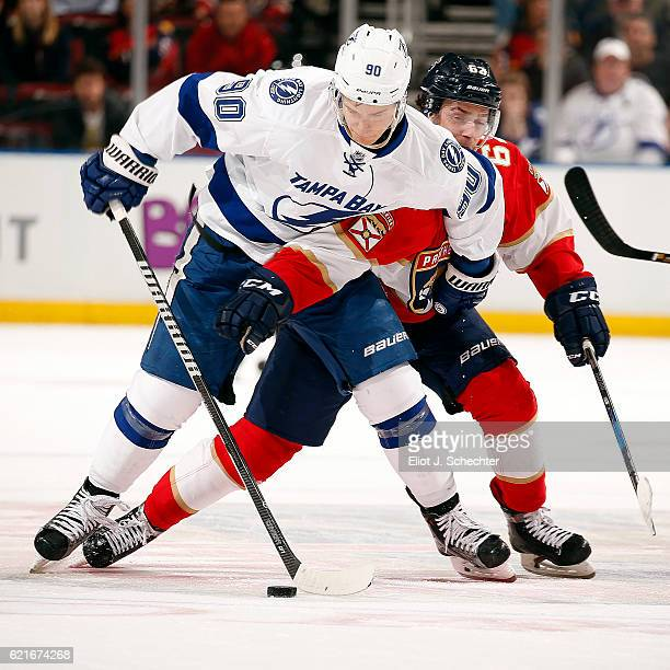 Denis Malgin of the Florida Panthers tangles with Vladislav Namestnikov of the Tampa Bay Lightning at the BBT Center on November 7 2016 in Sunrise...