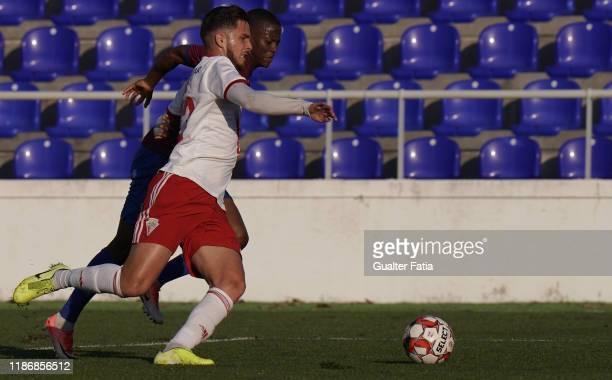 Denis Martins of UD Vilafranquense with Alex Kakuba of CD Cova da Piedade in action during the Liga Pro match between CD Cova da Piedade and UD...