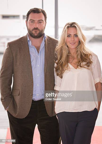 Denis Menochet and Miranda Raison pose during the photocall of 'Spotless' at Mipcom 2014 on October 13 2014 in Cannes France