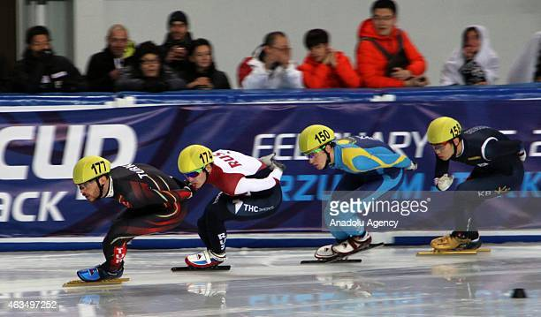 Denis Nikisha of Kazakhstan #174 Ruslan Zakharov and Serdar Iltir of Turkey compete during the Men's 1000m B final on day two of the ISU World Cup...