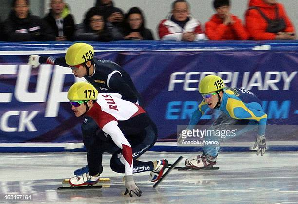 Denis Nikisha of Kazakhstan and Ruslan Zakharov compete during the Men's 1000m B final on day two of the ISU World Cup Short Track Speed Skating on...