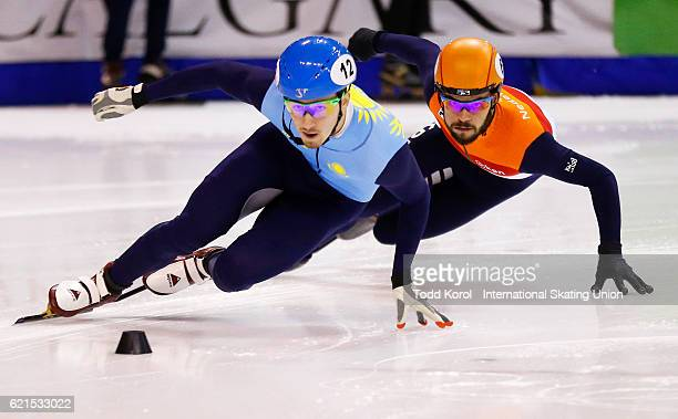 Denis Nikisha of Kazakhstan leads Sjinkie Knegt of the Netherlands in the men's 500 meter semi final during the ISU World Cup Short Track Speed...