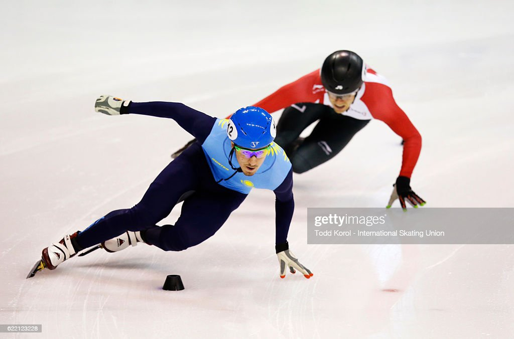 Denis Nikisha of Kazakhstan leads William Preudhomme of Canada in the men's 500 meter quarter final during the ISU World Cup Short Track Speed Skating event November 6, 2016 in Calgary, Alberta, Canada.