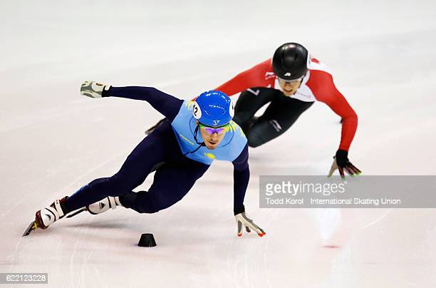 Denis Nikisha of Kazakhstan leads William Preudhomme of Canada in the men's 500 meter quarter final during the ISU World Cup Short Track Speed...