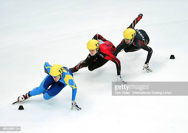 Denis Nikisha of Kazakhstan Leon KaufmannLudwig and Firat Yardimci of Turkey compete in Men's 1000m heats during day one of the ISU World Junior...