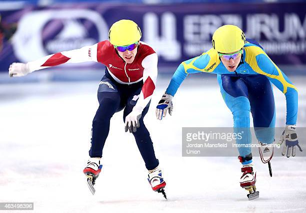 Denis Nikisha of Kazakhstan lunges for the line with Ruslan Zakharov of Russia during the Men's 1000m B final on day two of the ISU World Cup Short...