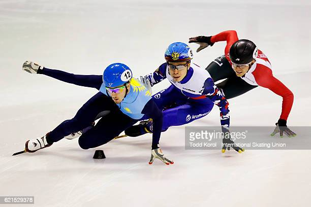 Denis Nikisha of Kazakhstan Semen Elistratov of Russia and Pascal Dion of Canada battle for position in the men's 500 meter quarter final during the...