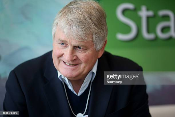 Denis O'Brien Irish billionaire and chairman of Digicel Group Ltd right speaks during a meeting at the Hotel Seehoff on day three of the World...