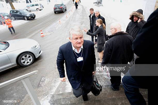 Denis O'Brien Irish billionaire and chairman of Digicel Group Ltd center arrives at the Hotel Seehoff on day three of the World Economic Forum in...
