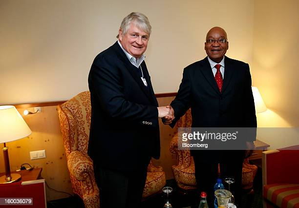 Denis O'Brien Irish billionaire and chairman of Digicel Group Ltd left greets Jacob Zuma president of South Africa during a private meeting at the...