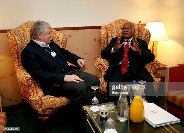 Denis O'Brien Irish billionaire and chairman of Digicel Group Ltd left speaks with Jacob Zuma president of South Africa during a private meeting at...