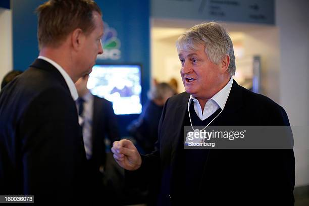 Denis O'Brien Irish billionaire and chairman of Digicel Group Ltd right speaks with Hans Vestberg chief executive officer of Ericsson AB at the...