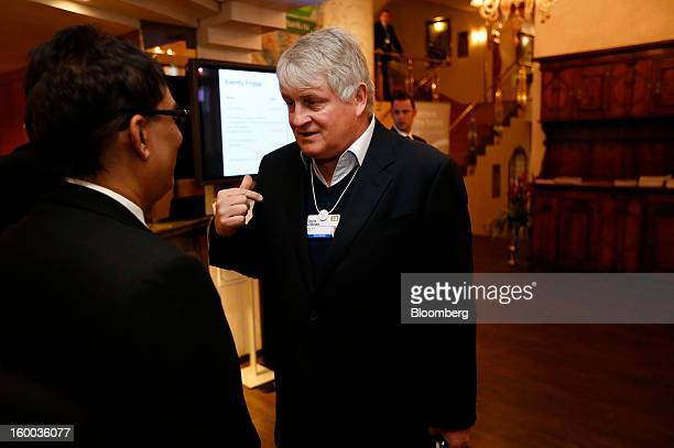 Denis O'Brien Irish billionaire and chairman of Digicel Group Ltd right speaks to Jacob Zuma's aide ahead of a private meeting with the South African...