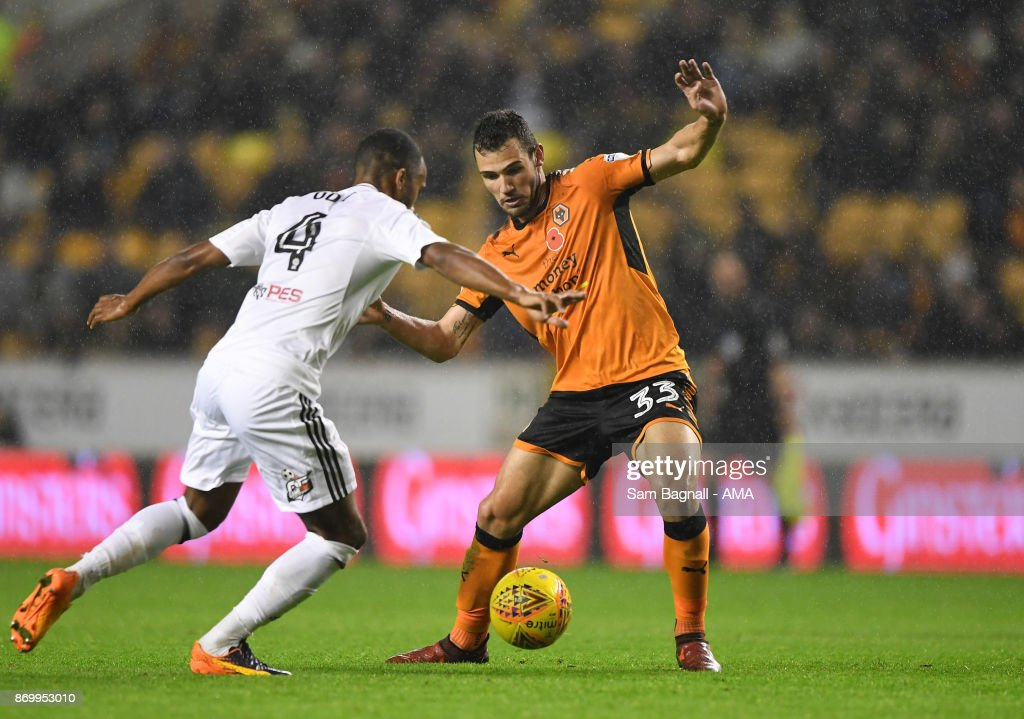 Denis Odoi of Fulham and Leo Bonatini of Wolverhampton Wanderers during the Sky Bet Championship match between Wolverhampton and Fulham at Molineux on November 3, 2017 in Wolverhampton, England.