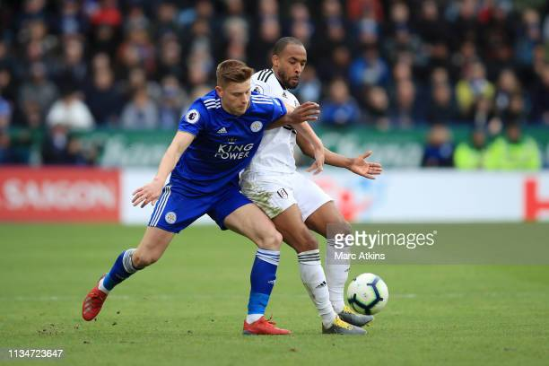 Denis Odoi of Fulham battles for possession with Harvey Barnes of Leicester City during the Premier League match between Leicester City and Fulham FC...