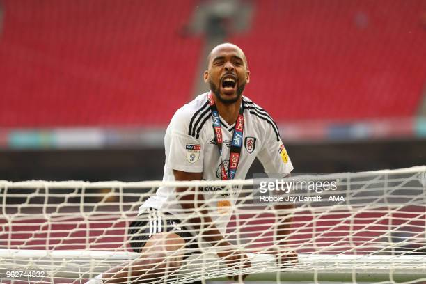Denis Odoi of Fulham celebrates on top of the goal posts at full time during the Sky Bet Championship Play Off Final between Aston Villa and Fulham...