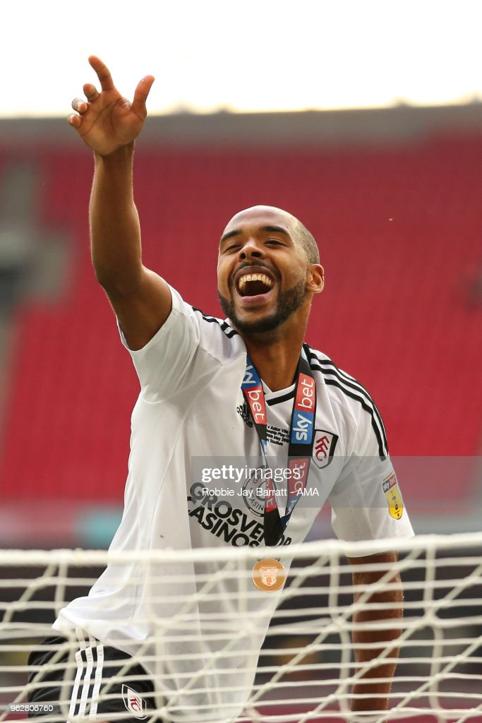 Denis Odoi of Fulham celebrates on top of the goal posts at full time during the Sky Bet Championship Play Off Final between Aston Villa and Fulham at Wembley Stadium on May 26, 2018 in London, England.