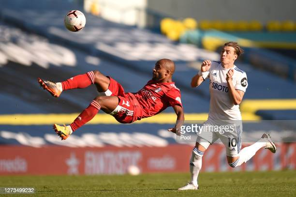 Denis Odoi of Fulham clears the ball from EzgjanaAlioski of Leeds United during the Premier League match between Leeds United and Fulham at Elland...