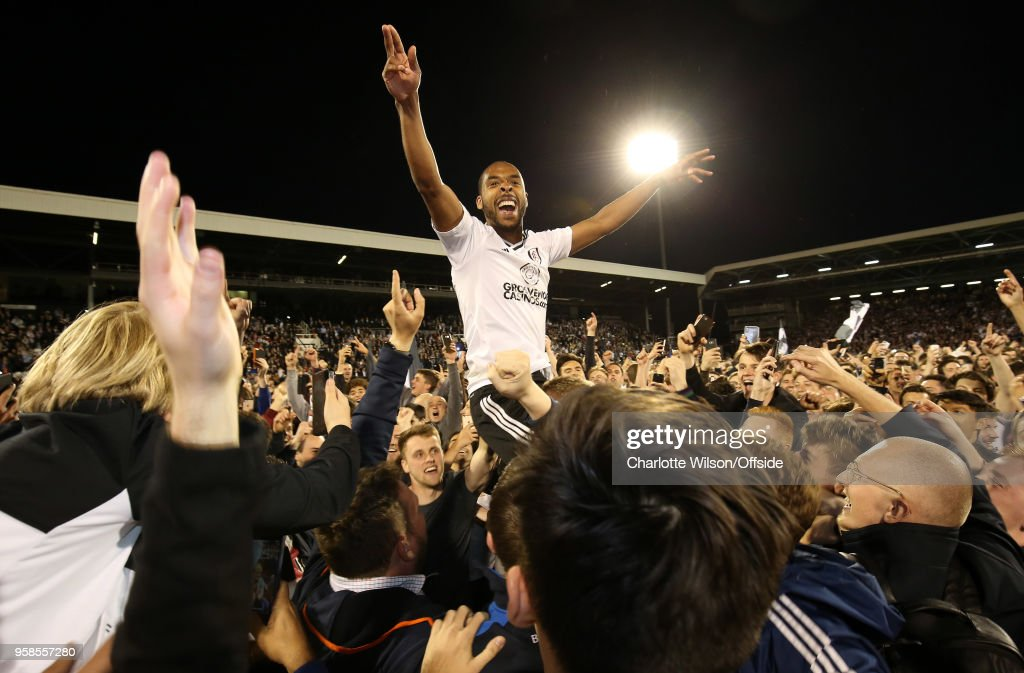 Denis Odoi of Fulham is carried on the shoulder of the fans as they celebrate making the play-off final during the Sky Bet Championship Play Off Semi Final:Second Leg match between Fulham and Derby County at Craven Cottage on May 14, 2018 in London, England.