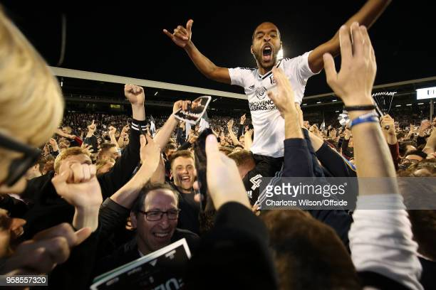 Denis Odoi of Fulham is carried on the shoulder of the fans as they celebrate making the playoff final during the Sky Bet Championship Play Off Semi...