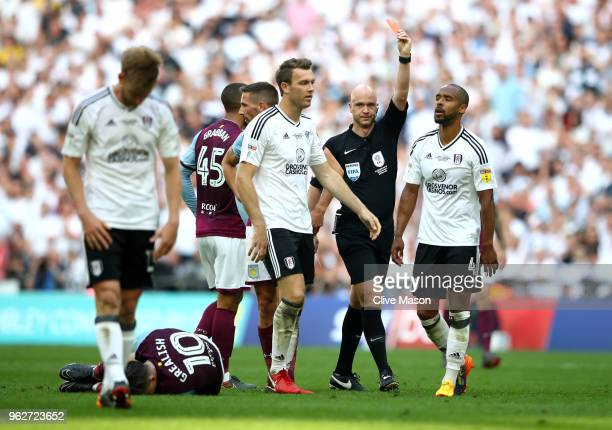 Denis Odoi of Fulham is shown a red card by referee during the Sky Bet Championship Play Off Final between Aston Villa and Fulham at Wembley Stadium...