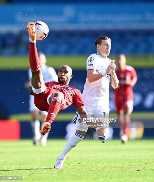 Denis Odoi of Fulham makes an overhead kick under pressure from Ezgjan Alioski of Leeds United during the Premier League match between Leeds United...