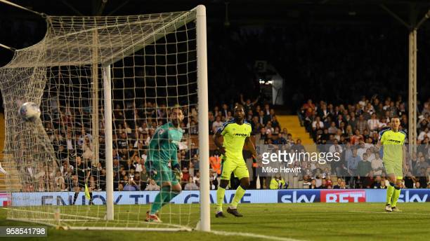 Denis Odoi of Fulham scores his sides second goal past Scott Carson of Derby County during the Sky Bet Championship Play Off Semi Final second leg...