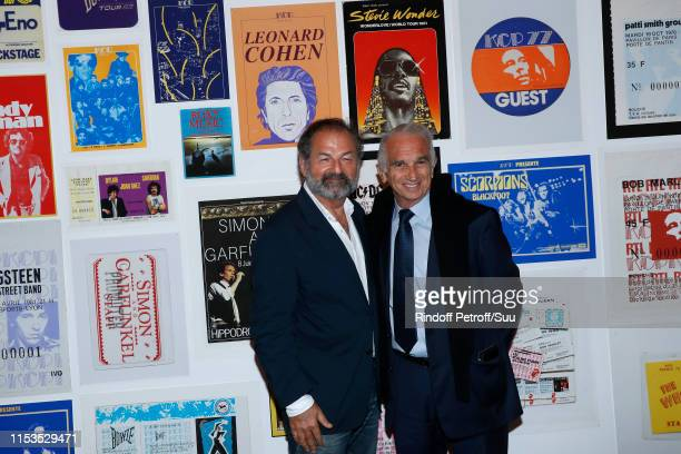 Denis Olivennes and Cesar Academy President Alain Terzian attend Albert Koski exposes its Rock&Roll Posters Collection at Galerie Laurent Godin on...