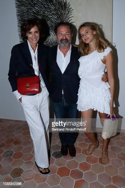 Denis Olivennes standing between Ines de la Fressange and her daughter Violette d'Urso attend the Kering Heritage Days Opening Night at 40 Rue de...