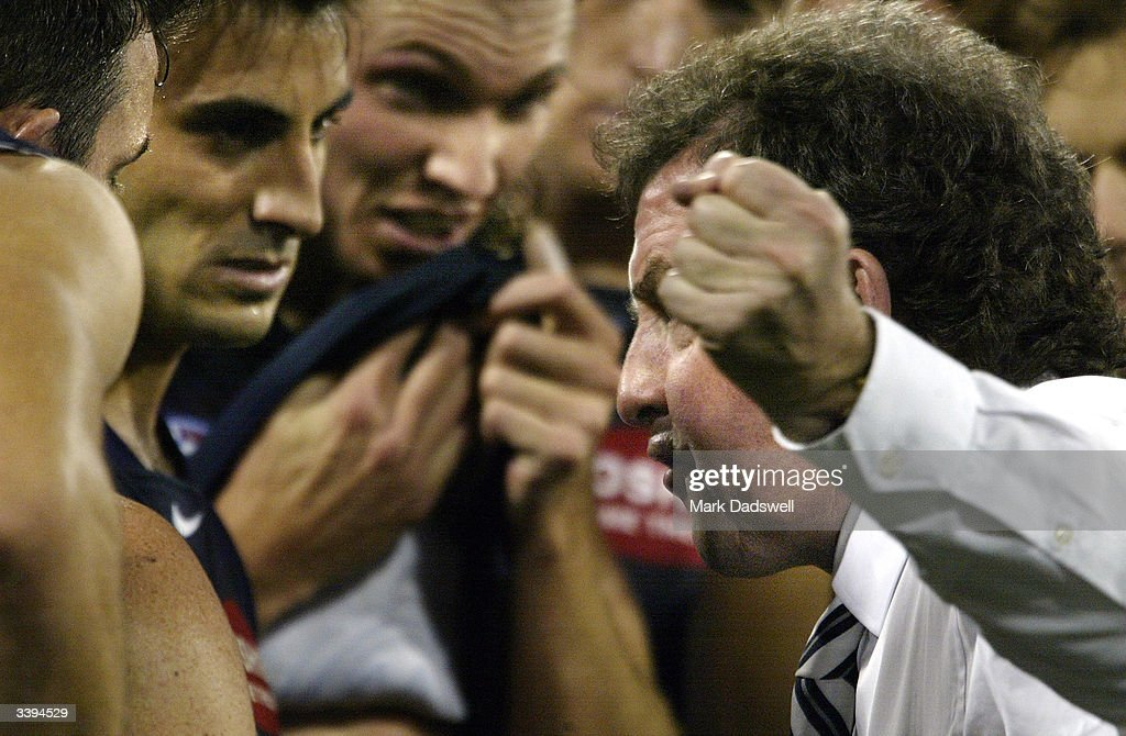 Denis Pagan coach of the Blues addresses his players during the round four AFL match between the Carlton Blues and the Essendon Bombers at the Melbourne Cricket Ground April 16, 2004 in Melbourne, Australia.