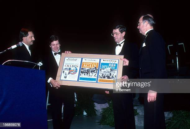 Denis Potvin head coach Al Arbour and general manager Bill Torrey accept an award during the 1983 NHL All Star dinner on February 7 1983 in Uniondale...
